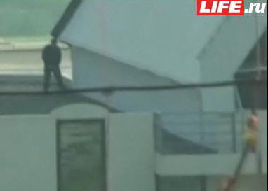 Sniper on the roof, while Bush visits Sochi.